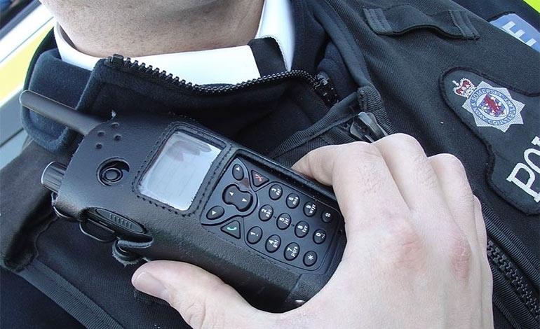 A policeman holding a radio