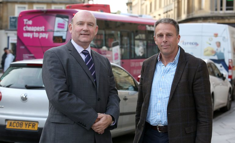 Tim Bowles standing with Tim Warren in the centre of Bath