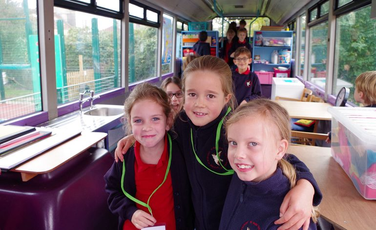Children inside the new bus classroom