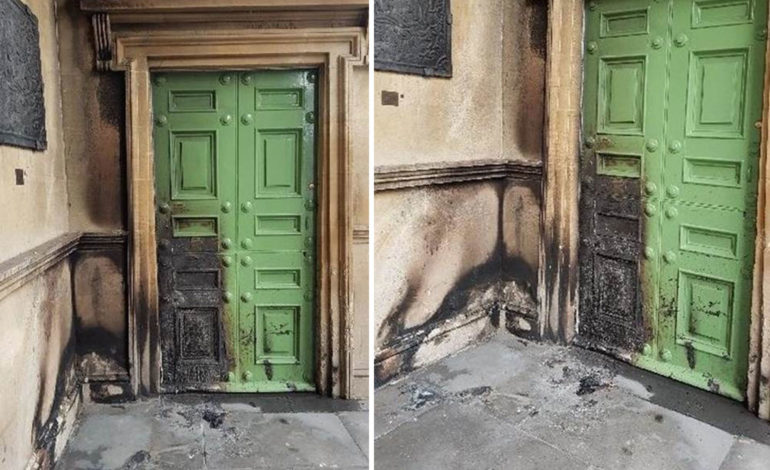 The burnt doors of the United Reform Church following an arson attack