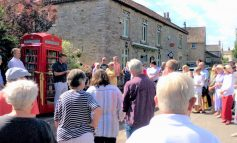 Corston telephone kiosk reopened as book exchange for village community