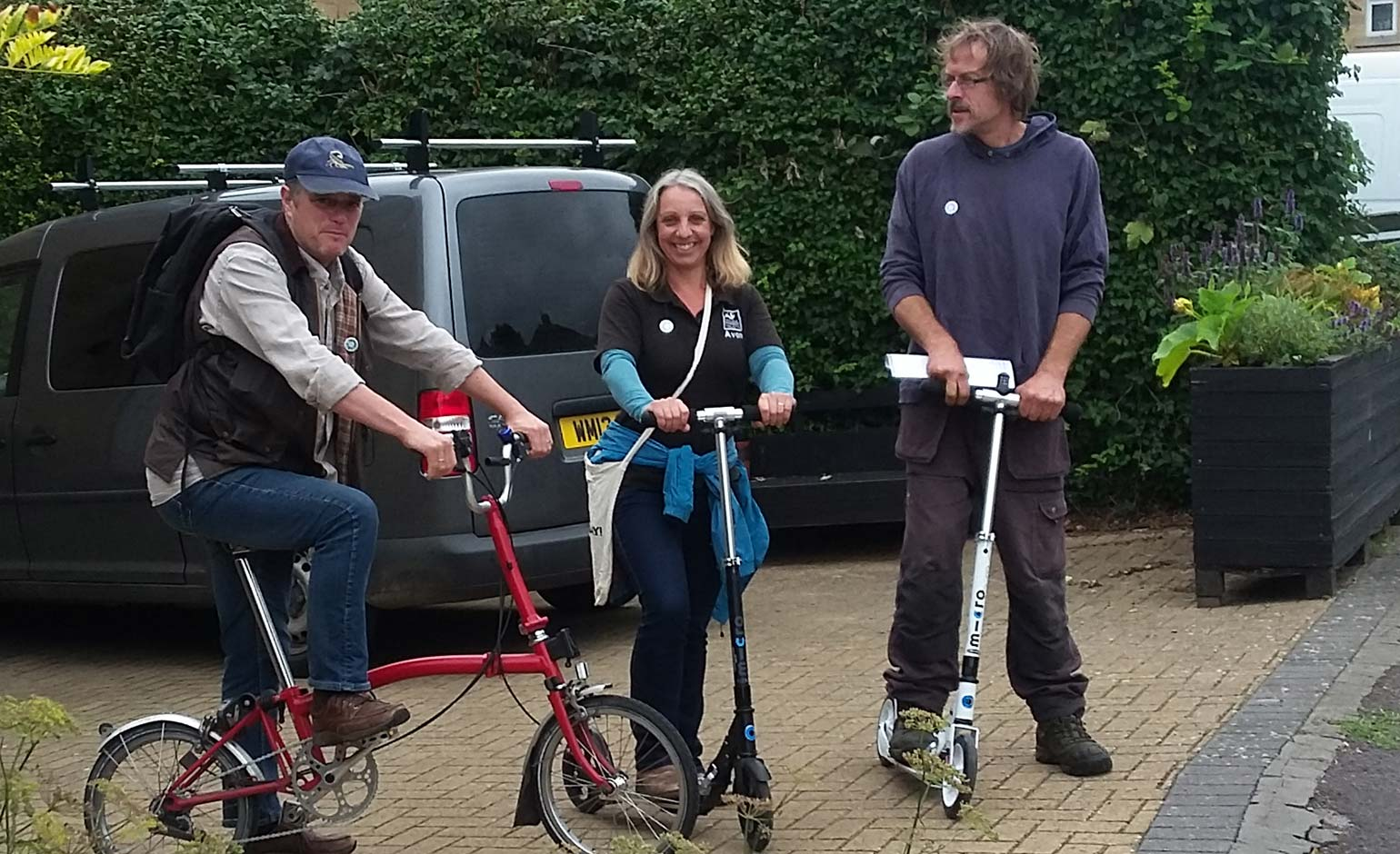 Judges take to two wheels for Blooming Whiteway's garden competition