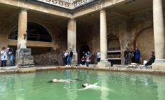 Local Extinction Rebellion activists take to the water of the Roman Baths