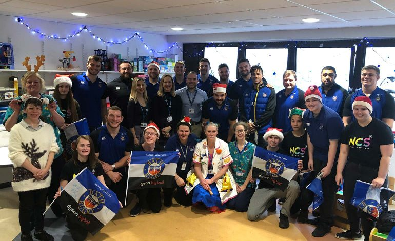 Bath Rugby players deliver gifts to children spending time in Bath's RUH