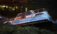 Boats partially submerged after water level in River Avon drops dramatically